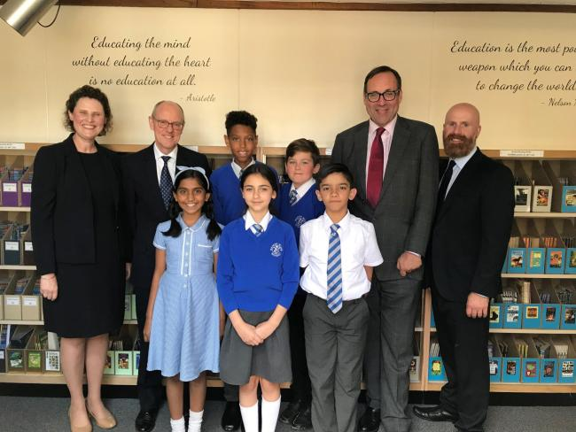 Nascot Wood head teacher Christina Singh (left) alongside Nick Gibb MP and deputy head Simon Watts (right) next to Watford MP Richard Harrington
