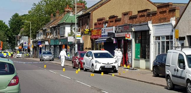 Forensic officers in Vicarage Road this afternoon