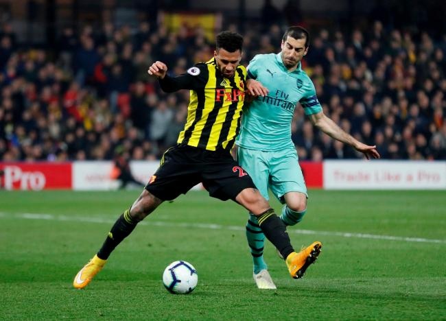 Etienne Capoue against Arsenal's Henrikh Mkhitaryan. Picture: Action Images