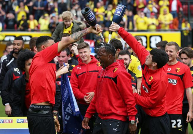 The Hornets stalwart gets a soaking as Watford celebrate their promotion to the Premier League. Picture: Action Images