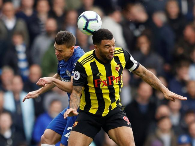 Troy Deeney challenges Chelsea's Cesar Azpilicueta. Picture: Action Images