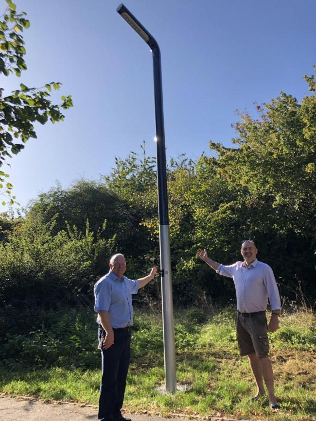 Cllr Stephen Giles-Medhurst (left) and Cllr Phil Williams (right) with the new street lamp (credit Three Rivers District Council)