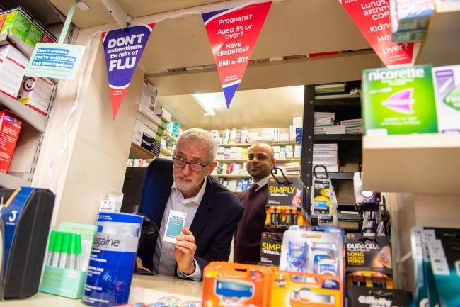 Labour leader Jeremy Corbyn with Pharmacist Manpreet Athwal during a visit to the Tudorken Pharmacy in Watford to talk about his party's NHS plans. Credit: Dominic Lipinski/PA