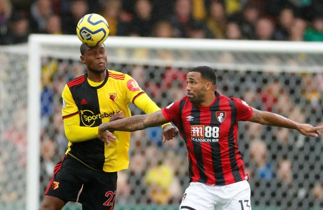 Christian Kabasele tussles with Callum Wilson. Picture: Action Images