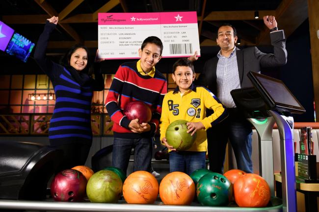 The Somani family with their 'boarding pass' to Hollywood