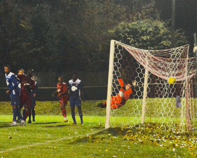 Sacha M'Baye heads in Northwood's equaliser against North Greenford on Tuesday night. Picture: Len Kerswill