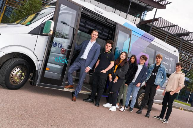 Mayor Peter Taylor with West Herts College next to the new minibus. Credit: Simon Jacobs