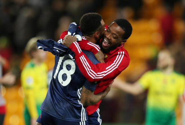 Nathaniel Chalobah celebrates with Andre Gray. Picture: Action Images