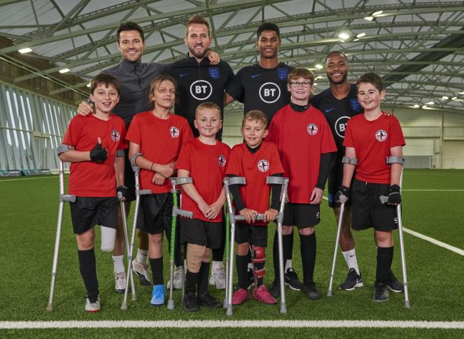 Rio Woolf (far right) pictured at St George's Park with Mark Wright, back left, and England's Harry Kane, Marcus Rashford, and Raheem Sterling. Credit: BBC