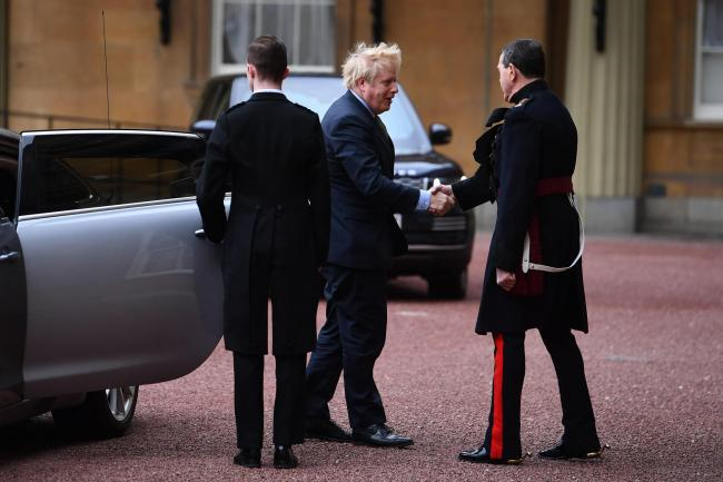 Prime Minister Boris Johnson arrives at London's Buckingham Palace for an audience with Queen Elizabeth II after the Conservative Party was returned to power in the General Election with an increased majority. PA Photo. Picture date: Friday December 1