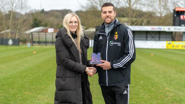 Clinton Lancaster receives his manager of the month award from Watford Ladies general manager Grace Williams. Picture: Andrew Waller