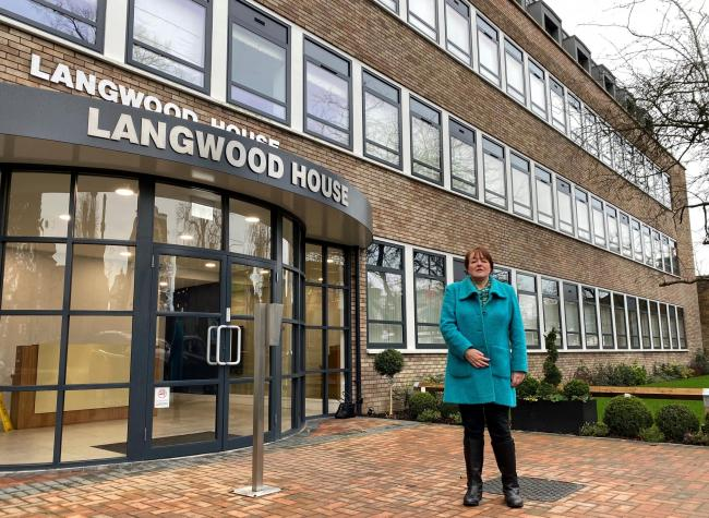 Cllr Sara Bedford pictured outside Langwood House, Rickmansworth, which is an example of an office building which has been converted into flats