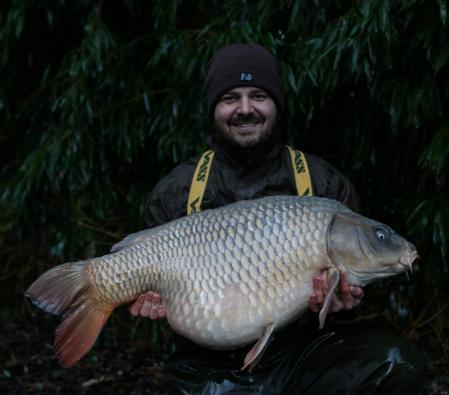 Aaron Foster with the ghost carp that he caught (photo Aaron Foster)
