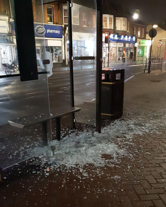 Shards of glass were left when a bus stop was smashed (Photo: Dennis Walting)