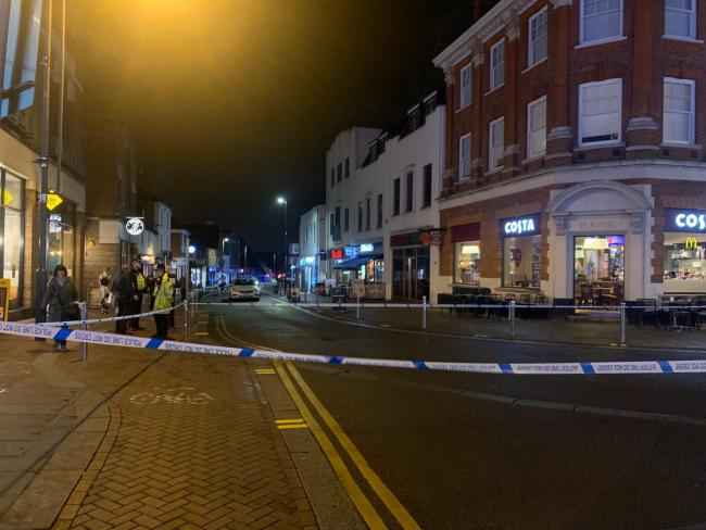Police tape off Watford High Street