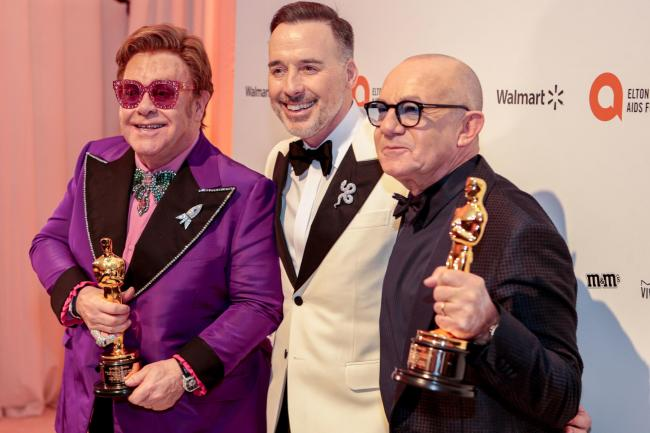 Elton John, David Furnish and Bernie Taupin celebrate  the win (Photo: PA Wire)