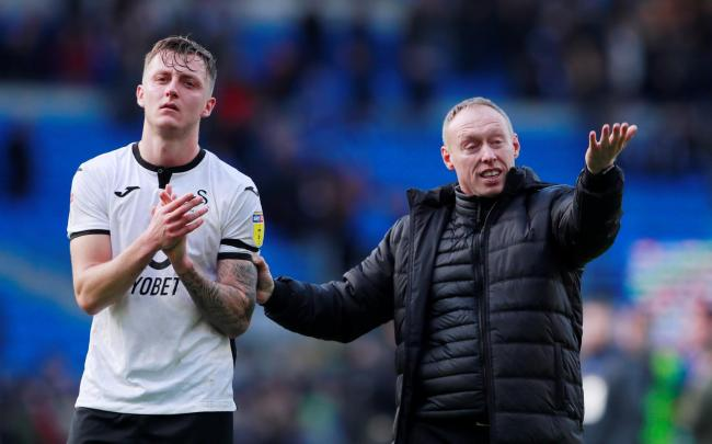 Ben WIlmot with Swansea head coach Steve Cooper. Picture: Action Images