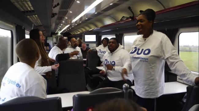 The choir performing on the train