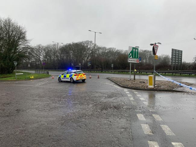 Police block off access to the A405 at the junction with Oakwood Road