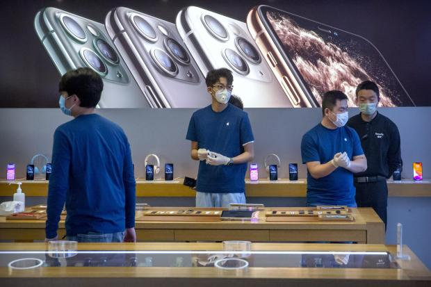 Watford Observer: Apple Store workers wear face masks