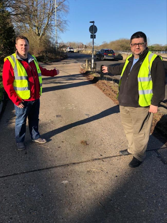 Cllr Richard Smith (left) with his colleague Cllr Asif Khan on the slip road that cuts through to the A41
