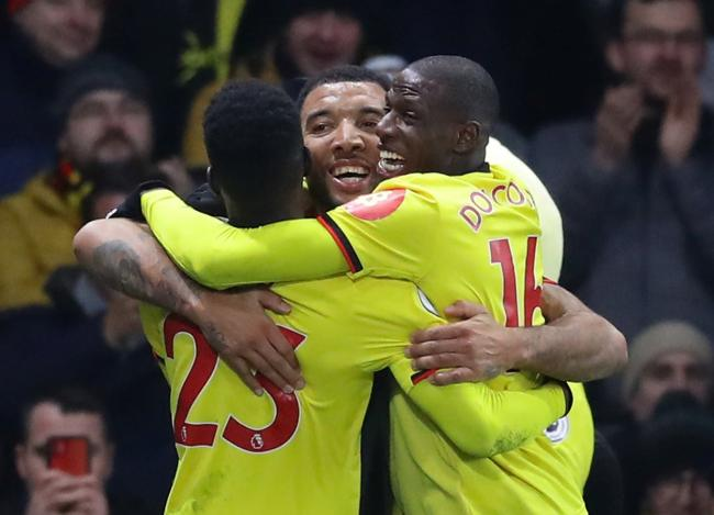 Troy Deeney celebrates his goal with Ismaila Sarr and Abdoulaye Doucoure. Picture: Action Images