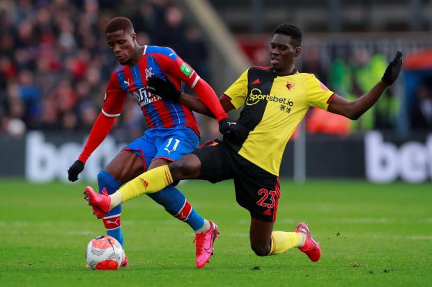 Ismaila Sarr tries to win the ball off Wilfried Zaha. Picture: Action Images
