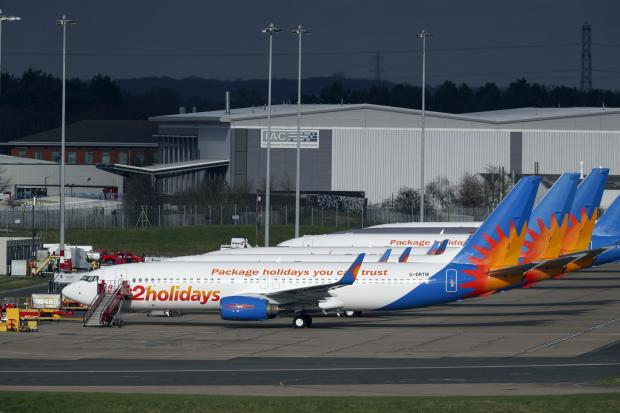 Watford Observer: AIRLINE: Several Jet2 planes have been parked up at Birmingham Airport during the pandemic. Picture: Steve Parsons/PA