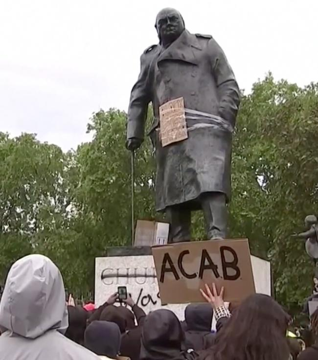 The statue of Churchill in Parliament Square was among those vandalised at the weekend (Photo: Sky News).