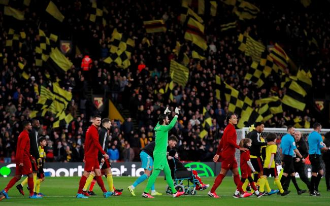 Watford and Liverpool walk out into a full Vicarage Road. Picture: Action Images