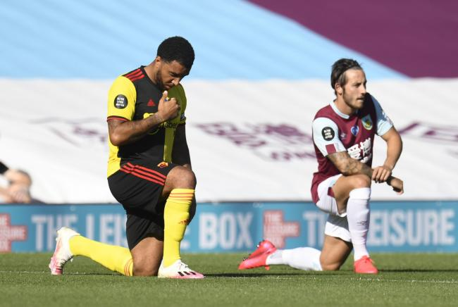 Troy Deeney kneels before kick off at Turf Moor. Picture: Action Images