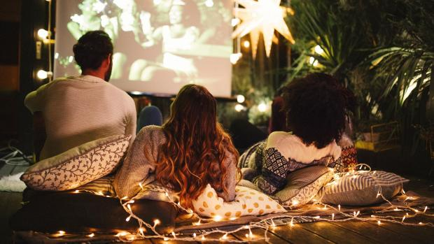 Watford Observer: Sit back and relax with a projector and outdoor screen. Credit: Getty Images / M_A_Y_A