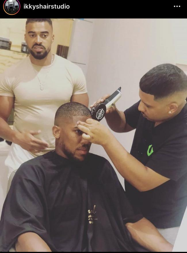 An Instagram post shows Anthony Joshua getting a haircut by a Watford Barber. Photo: Instagram