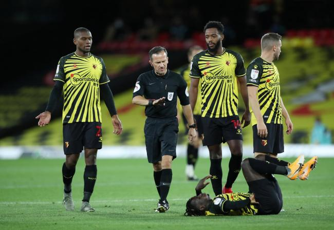 Soccer Football - Championship - Watford v Middlesbrough - Vicarage Road, Watford, Britain - September 11, 2020   Watford's Nathaniel Chalobah and Christian Kabasele speak with referee Keith Stroud   Action Images/Peter Cziborra    EDITORIAL USE ONLY.