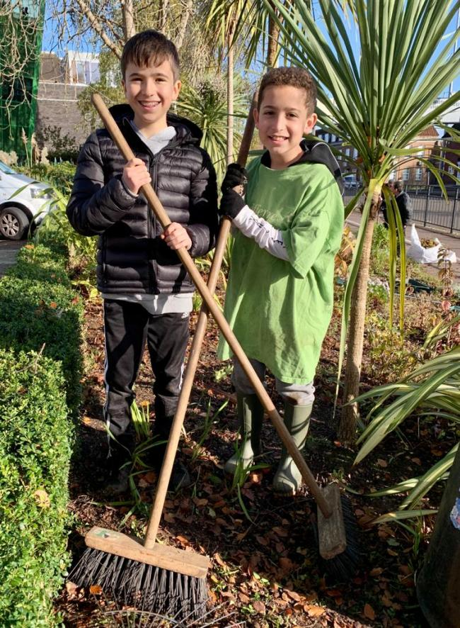 Members of Bushey Synagogue's Barmitzvah club gardening at The Peace Hospice