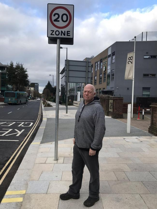 Councillor Stephen Giles-Medhurst standing by a 20mph zone in Clarendon Road in Watford