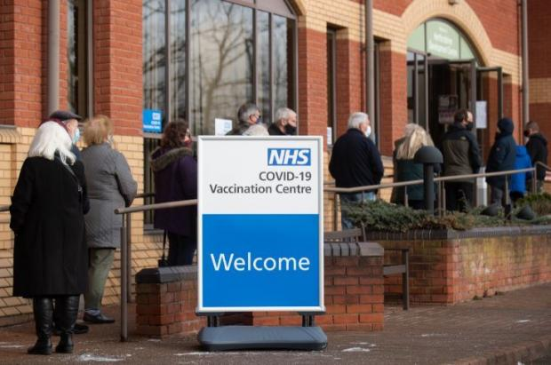 Watford Observer: Eligible residents wait for their first dose of the Covid vaccine at Robertson House in Stevenage. Credit: PA