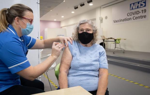 Watford Observer: Margaret Austin, 87, on her first time out of the house in six months, receives an injection of a Covid-19 vaccine. Credit: PA