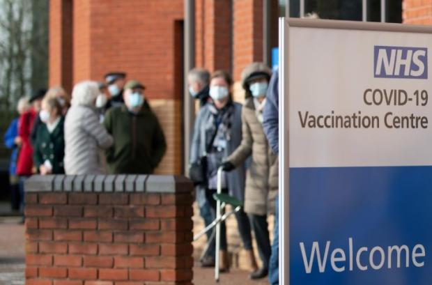 Watford Observer: Hertfordshire County Council offices and conference centre Robertson House has been temporarily turned into a mass Covid vaccination centre. Credit: PA