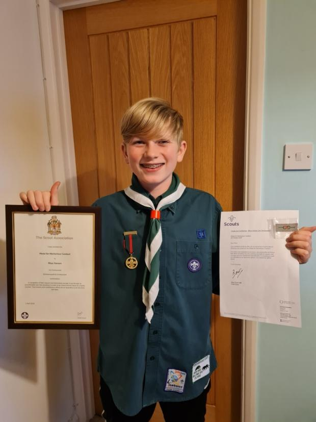 Watford Observer: Rhys Hanson with his honour. Credit: Rickmansworth and Chorleywood Scouts