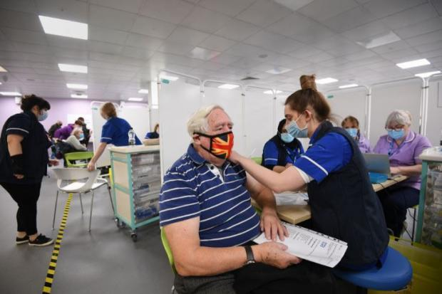 Watford Observer: A patient receives a Covid vaccine at Robertson House in Stevenage. Credit: PA