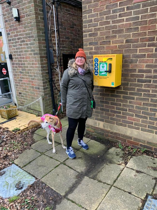 Community campaigner CLeare Feahy pictured by a defibrillator at Watford Rural Parish Council's hall