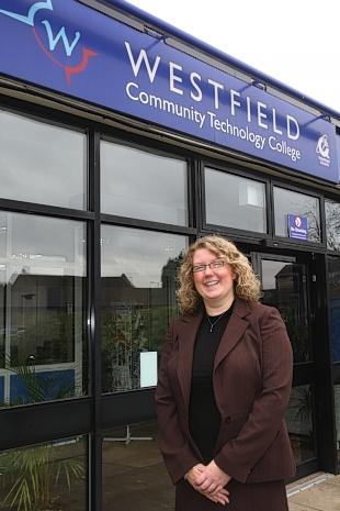 Headteacher Emma Aylesbury outside Westfield Community Technology College, in Tolpits Lane, Watford.