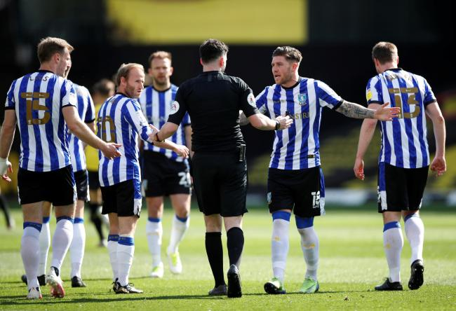 Sheffield Wednesday players protest with referee Chris Kavanagh. Picture: Action Images
