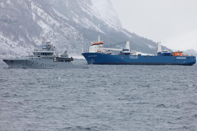 The Dutch cargo ship Eemslift Hendrika is guided to land at Alesund, Norway