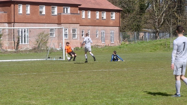 Gary Froy (number 15) opens the scoring for Rifle Volunteer