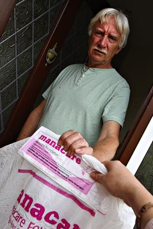 North Bushey resident Gerry McCormick with one of the bags posted through his door