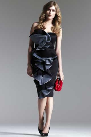 Ben De Lisi – satin ruffle front bandeau dress, £140 and sweetheart bag for a splash of colour, £30. Picture: Debenhams
