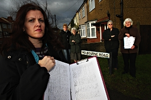 More than 200 residents have signed a petition by Kathryn Nicolai (foreground) against plans to build a mobile phone mast in Bushey