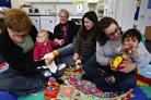 Parents and children at Beechfield Children's Centre, managed by Watford YMCA and its director of operations, Ruth Ellis (second left).